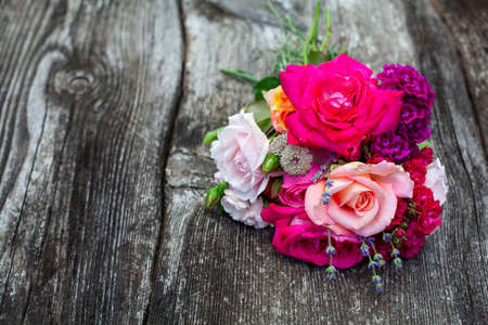 boquet of roses on old wooden surface