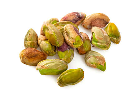 peeled pistachio nuts isolated on white Stock Photo