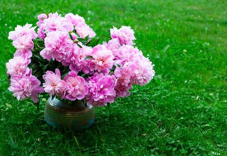 bouquet of peonies in vase in garden Stock Photo