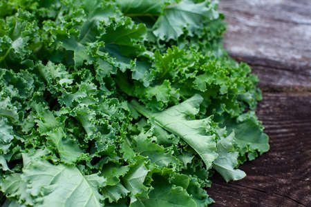 fresh kale cabbage on wooden surface Stock Photo