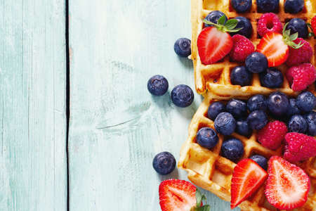 sweet belgian waffles with berries and chocolate cream Stock Photo