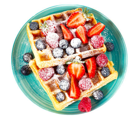 waffles with berries isolated on white