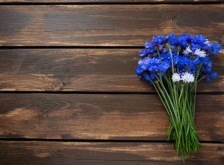 Blue Cornflower Herb on wooden surface Stock Photo
