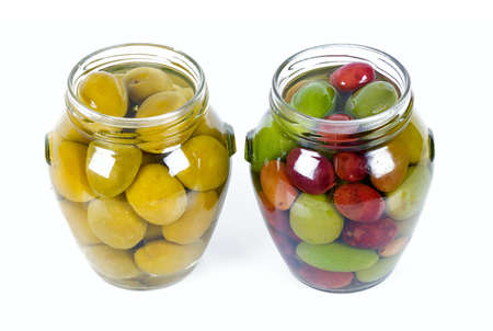 pickled olives in a glass jar isolated on white