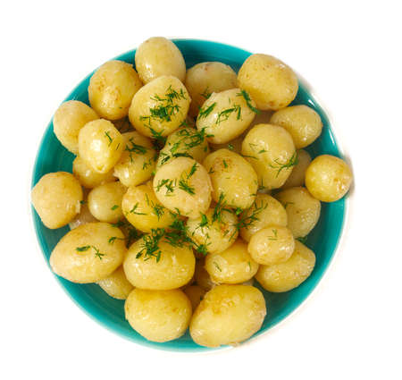 boiled new potatoes isolated on white
