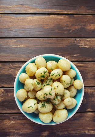 boiled new potatoes on a wooden surface Zdjęcie Seryjne
