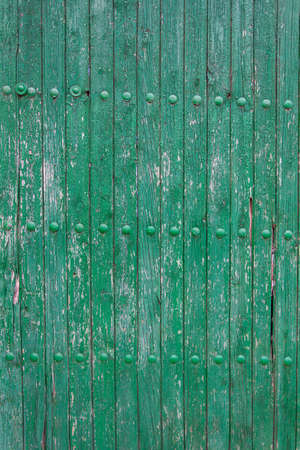 old painted green wooden wall