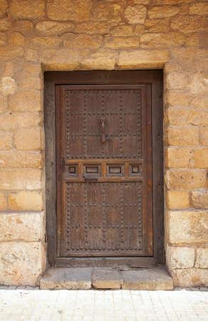 wooden door in old stone wall