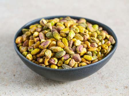 pistachio nuts on granite surface Standard-Bild