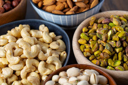 assortment of nuts on wooden surface Stockfoto