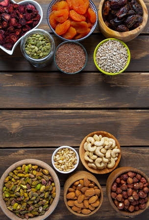 nuts, seeds and dried fruis on wooden surface Stok Fotoğraf