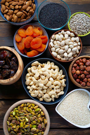 nuts, seeds and dried fruis on wooden surface Stockfoto