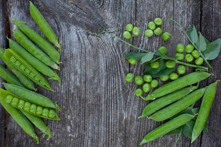 fresh pea on dark wooden surface