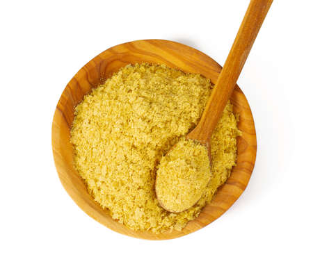 nutritional yeast flakes isolated on white background