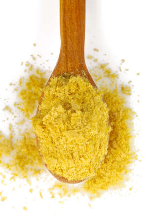 Nutritional yeast flakes isolated on white