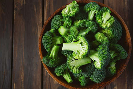 fresh broccoli on wooden surface