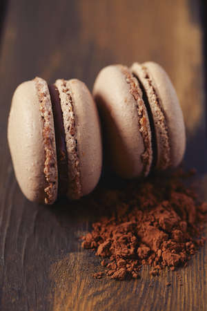 chocolate macaroon on brown wooden surface