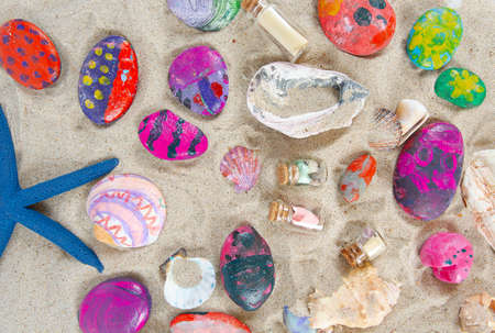 painted colorful sea shells and stones 写真素材