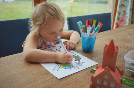 cute girl is painting at home Standard-Bild