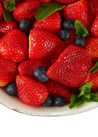 fresh strawberries and blueberries isolated no white