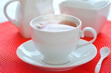 steamy: Hot steamy tea in a white cup