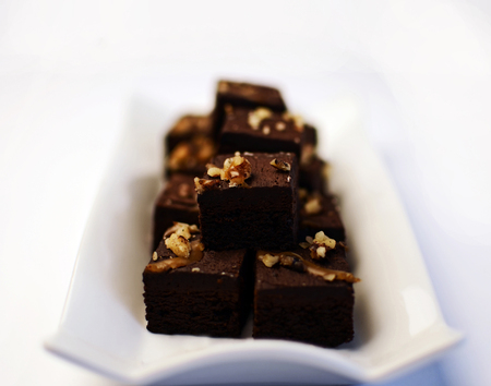 freshly cooked: Freshly cooked brownies on a white plate Stock Photo