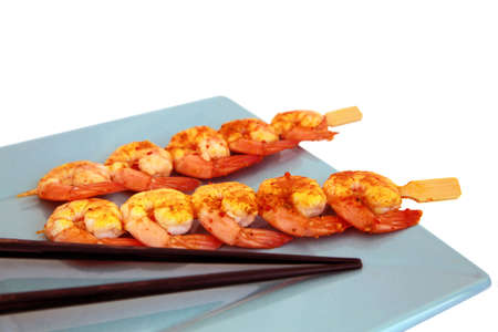 Shrimp Skewers on plate with chopsticks