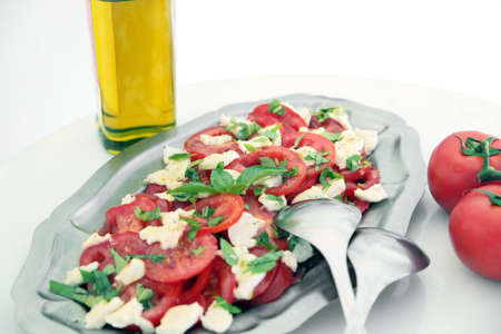 Caprese Salad (tomatoes, basil, mozzarella, olive oil) Stock Photo