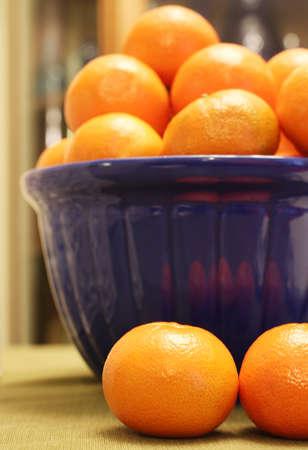 orange clementines blue bowl
