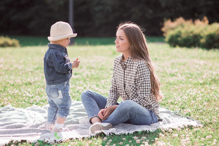 mother and daughter on a walk in nature. sunny photo with a dandelion. parents, love Stock Photo