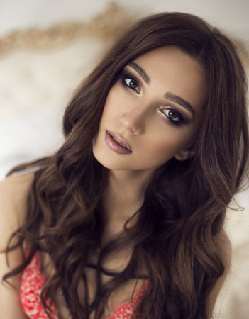 beautiful young girl with makeup and curls. fashion make black eyes