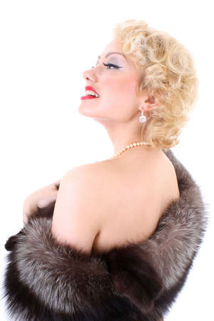 Young beautiful blondie woman with fur collar dreaming. Marilyn Monroe imitation Stock Photo - 7633318