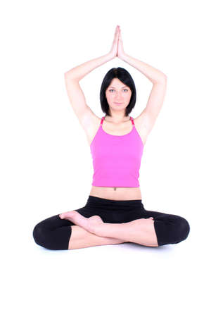 sitting woman in pink doing yoga photo