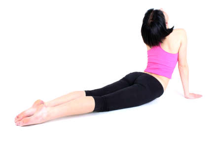 woman in pink t-shirt doing yoga photo