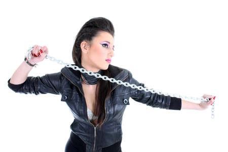 Young beautiful girl in black with chain photo