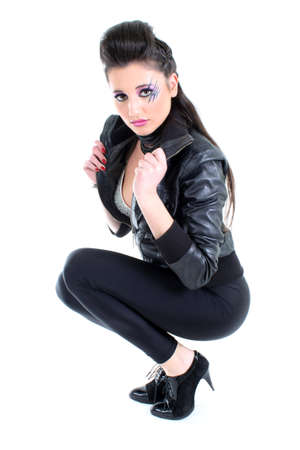 Young beutiful girl in black leather jacket photo