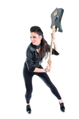 Young beautiful girl in black leather jacket with bass guitar photo