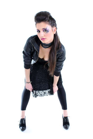 Young beautiful girl in black leather jacket photo