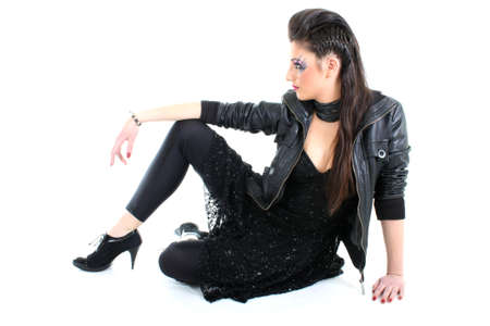 Young beautiful model in black leather jacket photo