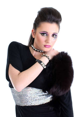 Young beautiful girl in black dress with fur photo