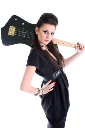 Young beautiful girl in black with bass guitar photo