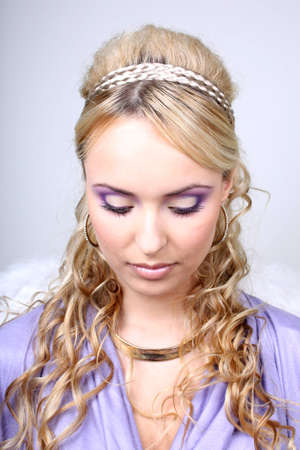 young blonde in violet with curly hair photo