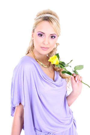 young beautiful blonde with violet make-up and yellow rose photo