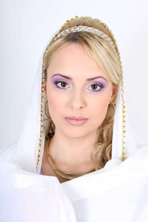 young beautiful blonde with violet make-up and yashmak photo