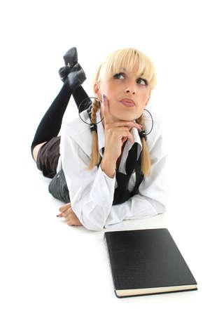 cute blondie schoolgirl with book dreaming photo