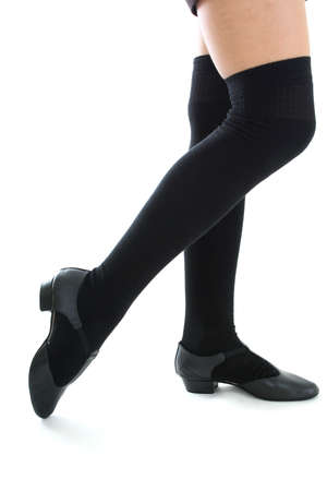 female legs in black kneesocks photo