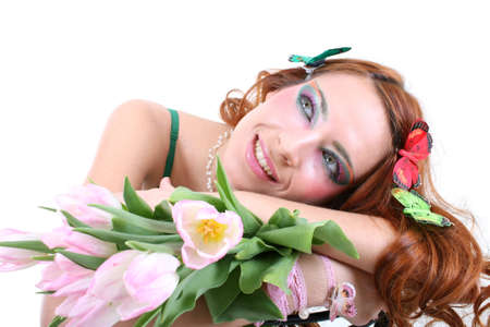 Red-haired woman with tulips and butterflies on her head photo