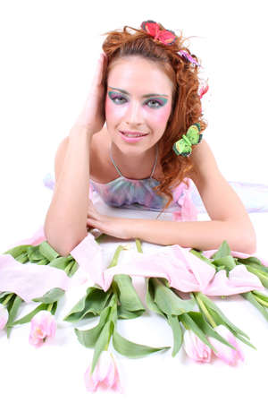 Red-haired woman with tulips and butterflies on her head lying photo