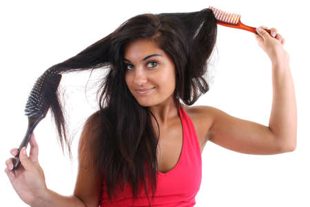 young pretty woman in pink brushing her hair with brush and comb Stock Photo - 7666891