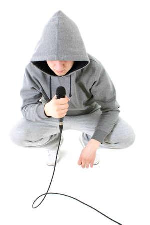 Rapper with dynamic microphone in sportswear